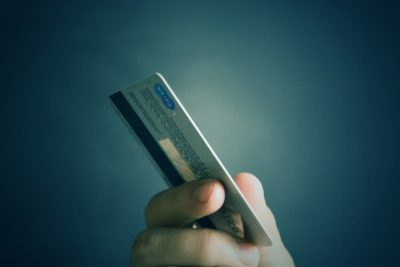 credit card in hand to pay on a freelance translation website